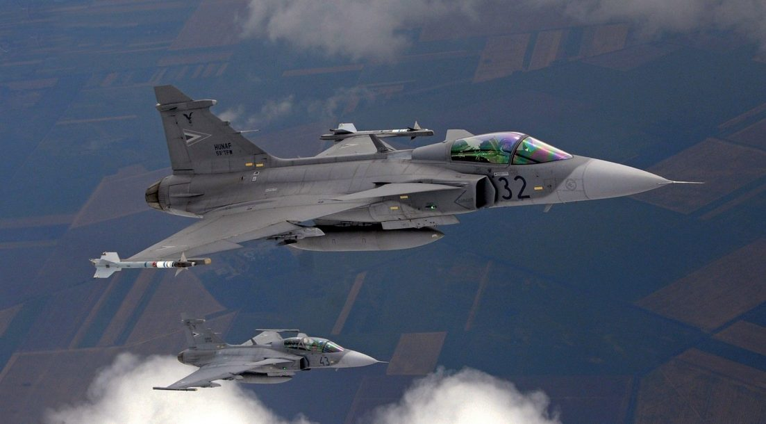 Gripen Fighter planes aircraft construction vehicles skies Jet