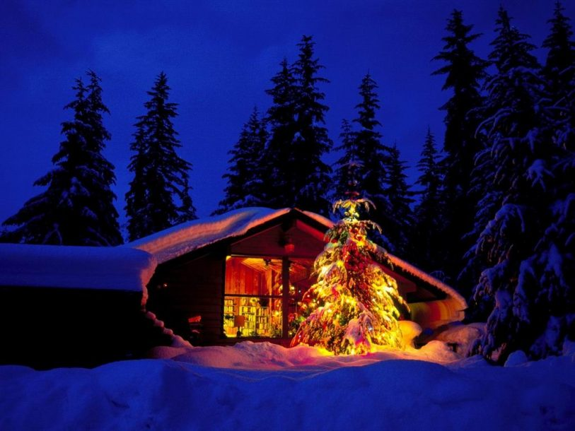 Christmas cottage with lights wallpaper
